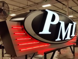 Custom Shaped Aluminum Cabinet, Face Lit Channel Letters, Neon and LED Lighting, Masked and Painted