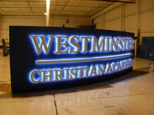 Curved Aluminum Fabricated Cabinet, Halo/Reverse Lit Channel Letters, Standoff Mounted